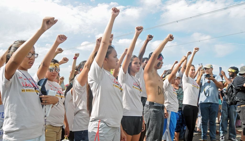 Protesters demonstrate on August 11, 2016 against the start of construction for the Dakota Pipeline Project. (Photo credit: Tom Stromme / Associated Press)