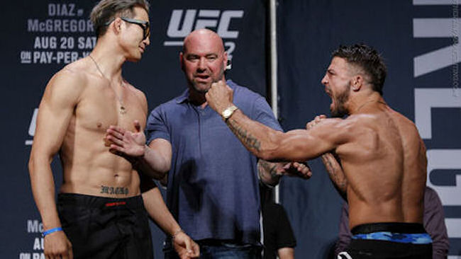 Hyun Guy Lim (left) faces off against Mike Perry (right) at their pre-fight weigh-in earlier this month.