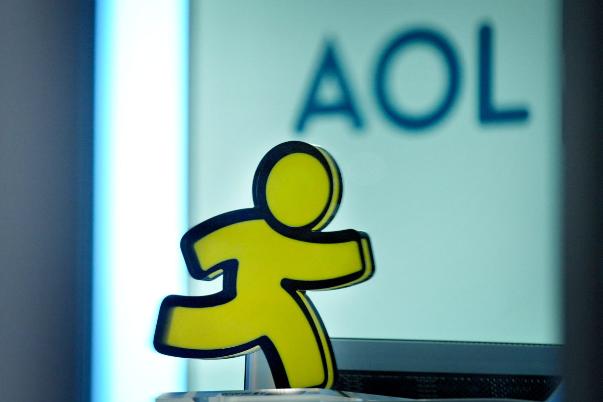 A logo and an AOL-messenger-figure is pictured at the entrance of the AOL office in Hamburg on January 12, 2010. US Internet company AOL announced on January 12 that it intends to close its French and German offices as part of a worldwide round of job cuts. In Germany, AOL will close its offices in Hamburg, Duesseldorf, Frankfurt and Munich, cutting 140 jobs, a spokesman said. AFP PHOTO DDP / PHILIPP GUELLAND GERMANY OUT (Photo credit should read PHILIPP GUELLAND/AFP/Getty Images)