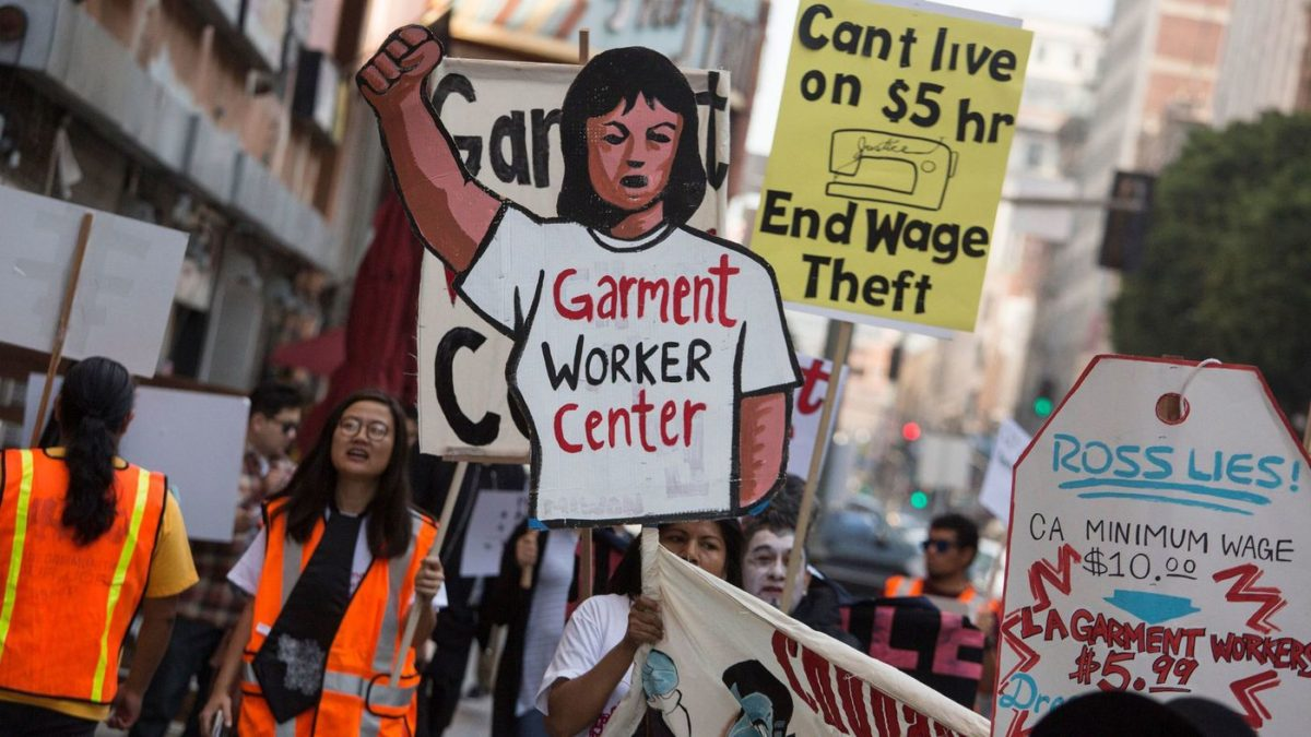 Garment workers rally in front of a Ross store on Broadway in downtown L.A. to demand an end to wage theft and unsafe working conditions on Oct. 25, 2016. (Los Angeles Times)